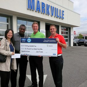 Craig and Sean Riley are pleased to present a cheque