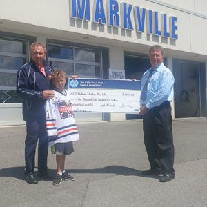 Steve Joyce is pleased to present a cheque