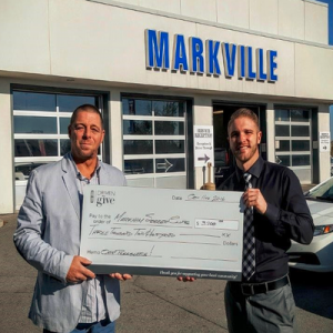 Kent Green of the Markham Soccer Club accepts a $3,200 cheque