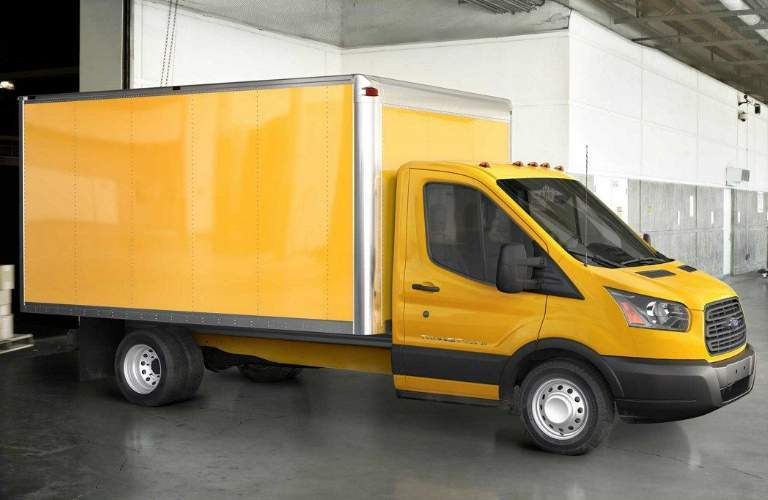 Yellow_2018_Ford_Transit_Chassis_Cab_Parked_by_a_Loading_Dock_in_a_Warehouse_o